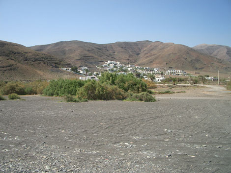 View from the beach of the village of Giniginamar